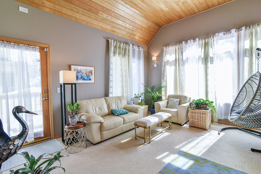A light filled family room / den that calls for you to sit down, relax and enjoy a conversation.